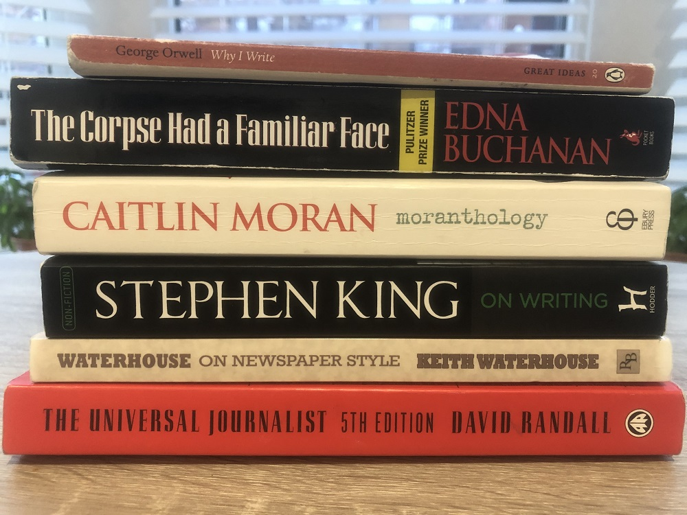 A pile of six books about journalism: Why I Write (small and brown), The Corpse Had A Familiar Face (large and black), moranthology (large and cream), On Writing (large and black), Waterhouse on newspaper style (small and cream) and The Universal Journalist (large and red).