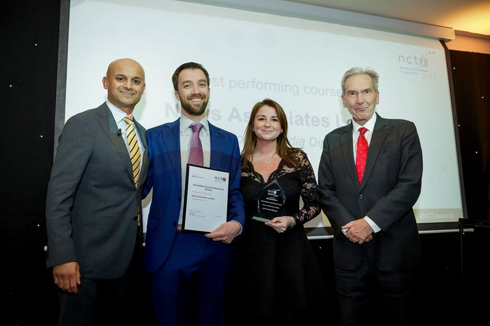 Graham Moody and Lucy Dyer collecting the awards for top NCTJ course and top fast-track course in 2019. They are with Sky Sports presenter Dharmesh Sheth and NCTJ chairman Kim Fletcher. They're all dressed up very smart with big smiles.