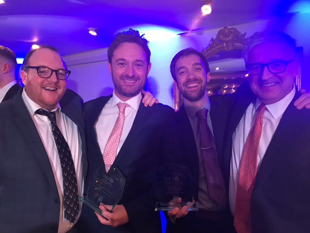 Andrew Greaves, James Toney, Graham Moody and Graham Dudman after winning top NCTJ journalism school in 2017. They are all dressed up in suits and big smiles!