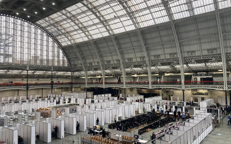 Photo of count at Olympia, London. Huge dome glass roof with counting booths across the large space.